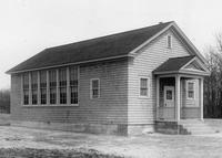 Front and side exterior view of newly constructed Drawbridge Colored School