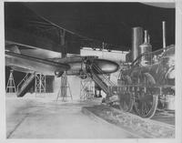 United Air Lines plane and locomotive in unidentified exhibition
