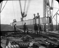 Beam being hoisted during construction of Quebec Bridge