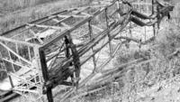 Frame of wrecked freight car, angular view, clearing house film