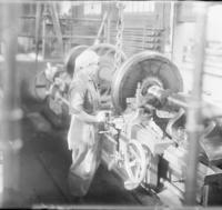 Female employee at lathe with car wheel and axle at Huntingdon, Pa.