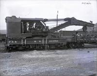 Wreck crane and mow car #490768, side view, at Hollidaysburg, Pa.
