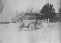Automobile in winter (motion shot)