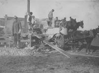 Horses and wagons at road construction site