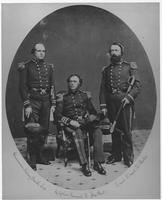 Captain Samuel Francis du Pont, seated, with Commander Sidney Smith Lee and Lt. David D. Porter