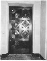 Interior carved door in Chamber of Commerce building