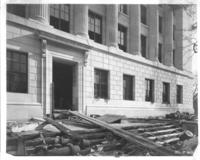 Exterior construction at doorway of Chamber of Commerce building