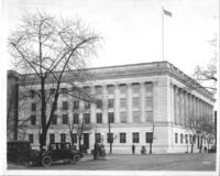 Exterior of Chamber of Commerce building with cars
