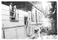Construction of Chamber of Commerce building with workers