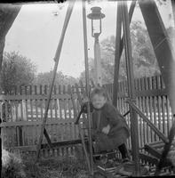 Unidentified child on swing