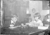 Tom Marshall, Jr. and his cousin Eleanor Marshall playing games in the living room