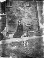 Woman, possibly Anna Marshall, with dog at Auburn Heights