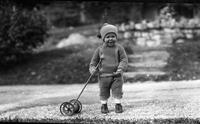 Tom Marshall, Jr., as a young child playing outdoors during winter