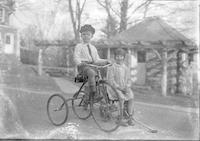 Thomas Marshall, Jr. and his cousin Eleanor Marshall with tricycle and wagon