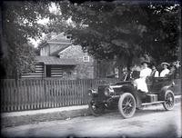 Four people in right-hand drive automobile