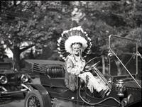 T. Clarence Marshall dressed as Indian Chief in Stanley 1912 Model 63 automobile