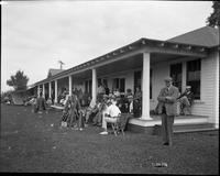People on Gun Club Porch during trapshooting event
