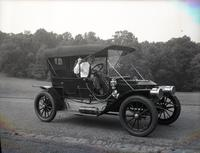 T. Clarence Marshall seated in 1910 Stanley Model 71 in Rockford Park