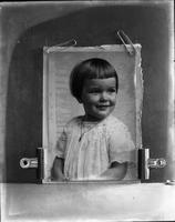 Copy photograph of young girl, likely Lorraine Marshall