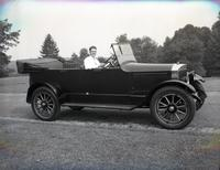 Thomas C. Marshall, Jr., seated in 1918 Stanley Model 735 at Rockford Park