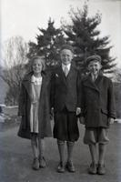 Tom Marshall, Jr., with two other children outside during winter