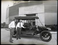 T. Clarence Marshall with Stanley Steamer at Hollywood-Perkins Plymouth Dealership