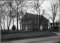 Unidentified brick building, likely a Quaker meeting house, with cemetery
