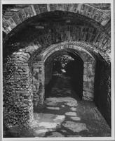 Brick arched pathway in Crowninshield Garden