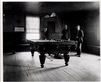 Three men playing pool inside Brandywine Workmen's Club House (Eleutherian Mills residence)
