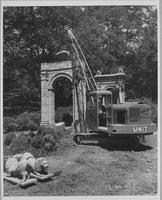 Monument being demolished in Crowninshield Garden