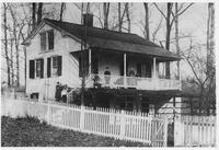 Family on porch of Woodside House, home of Pierre A. Gentieu