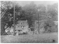 Windetts' house and trestle under construction on Breck's Lane in Henry Clay Village