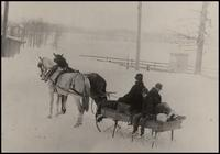 Horse-drawn sleigh after blizzard northwest of office of E.I. du Pont de Nemours & Co.
