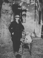 "William G. Betty with dog, ""Baby"""