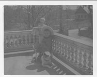 Boy with dog on balcony of Alfred I. du Pont's residence, The Swamp, on Breck's Lane