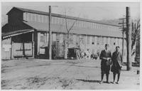 Two young men in front of New Machine Shop near Hagley Yard gates