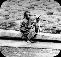 Chinese child with dog, Snooks