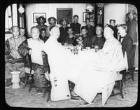 Group portrait of Chinese men and Henry Janvier seated at table