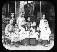 Group portrait of Henry Janvier with Chinese families