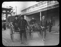 Henry Janvier and Henry Everall riding in rickshaw, China