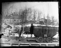 Horse drawn hopper car with solid wheels