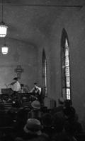 Church at Easter with three girls playing in orchestra