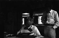 Frank Lloyd Wright in study at Taliesin