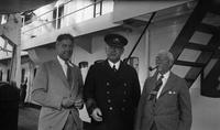 Frank E. Schoonover on ship with captain and unidentified man