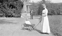 Cortlandt Schoonover as young child being pulled in wagon by his grandmother, Elizabeth LeBar Schoonover