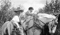 Cortlandt Schoonover on horse as a child with unidentified man