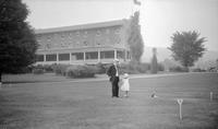 Frank and Elizabeth (Biz) Schoonover walking on landscaped grounds at unidentified location