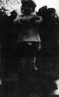 Elizabeth (Biz) Schoonover as young child in sweater and hat
