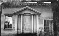 Doorway with four square columns and large pediment in Rockport, Massachusetts