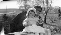 Cortlandt and Elizabeth (Biz) Schoonover as young children seated on tree stump